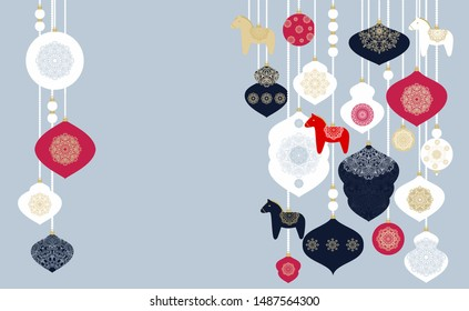 Scandinavian Christmas decoration, garlands with decorative balls and toy  dala horses on grey background