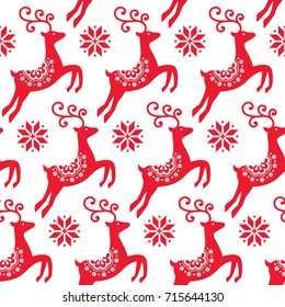 Scandinavian folk art Christmas vector pattern, Nordic red seamless design with reindeer and snowflakes  Xmas cute vector wallpaper, Norwegian repetitive background