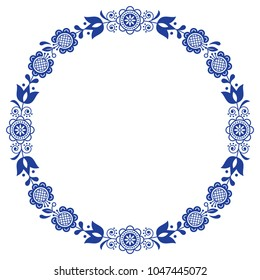 Scandinavian folk art floral werteth, vector ornamental round frame, design with flowers in circle, ethnic composition.  Retro flowers greeting card, birthday or wedding invitation design in navy blue