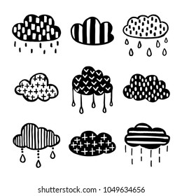 Scandinavian style hand drawn clouds set. Monochrome nursery decorative elements collection. Minimalistic cute drawings for prints, stickers, posters. Vector vintage illustration.