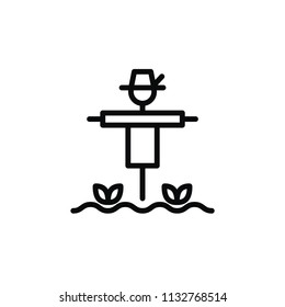 Scarecrow icon in line art. Scarecrow on the filed with plants in minimal style.