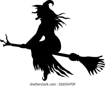 The scary witch flying on a broomstick