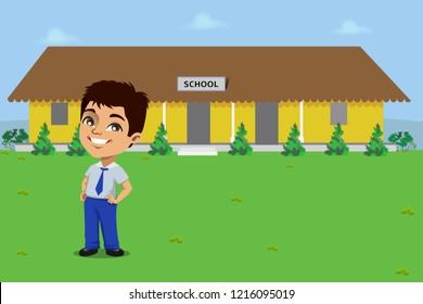 A school boy standing in his uniform in front of a rural Indian school building