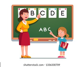 School student girl at lesson learning to write alphabet letters. Teacher help kid studying writing ABC on blackboard. Primary school class education. Flat vector classroom character illustration
