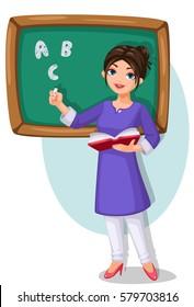 school teacher with green chalkboard holding a book