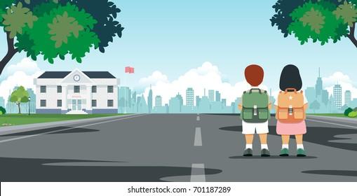 Schoolboy carrying student bag walks to school