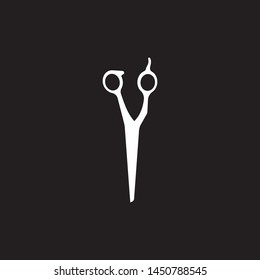 Scissors symbol isolated on black background