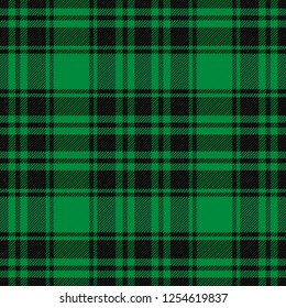 Scottish pattern in black and green cage. Scottish cage. Christmas and new year tartan plaid.  Traditional Scottish checkered background. Fabric texture. Vector illustration