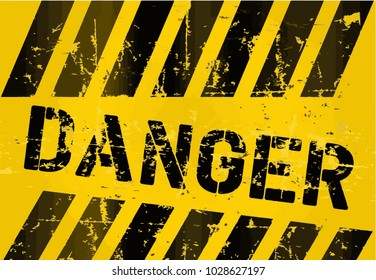 """Scratched dark inscription """"Danger"""" on yellow background"""