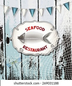 Seafood restaurant composition on the wooden background