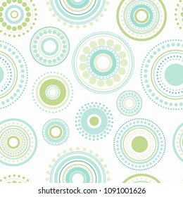 Seamless abstract pattern of circles and dots of green and turquoise colors. Kaleidoscope background. Decorative wallpaper, good for printing. Vector illustration. Ethnic style