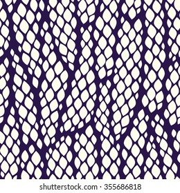 Seamless abstract pattern with colorful rhombuses. Vector illustration with leaves. Snake skin texture.