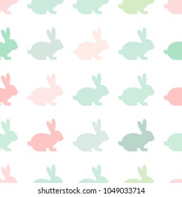 Seamless abstract pattern with Easter rabbits of different pastel colors. White background. Decorative holiday wallpaper, good for printing. Cute Vector illustration. Flat design