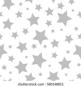 Seamless abstract pattern with grey  stars of different size on white background. Nice  Vector illustration.