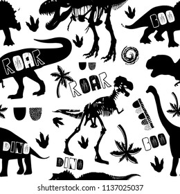 Seamless abstract pattern with silhouettes of dinosaurs. Children's pattern for textiles, fabrics, clothes, wrapping paper, wallpaper, bed linen, web, for boys.