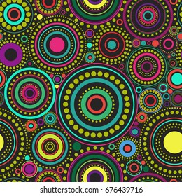 Seamless abstract pattern of vibrant bright circles and dots on black background. Kaleidoscope background. Decorative wallpaper, good for printing. Vector illustration. Ethnic style.