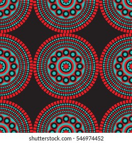 Seamless African pattern with circles and dots in red, teal and black