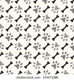 Seamless animal pattern of paw footprint and bone. Endless texture can be used for printing onto fabric, web page background and paper or invitation. Diagonal dog style. White and black colors.