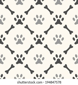 Seamless animal pattern of paw footprint and bone. Endless texture can be used for printing onto fabric, web page background and paper or invitation. Dog style. White and black colors.