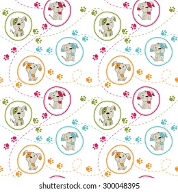 Seamless baby pattern. Cute colored puppies with green, pink, blue and yellow paws on white background.