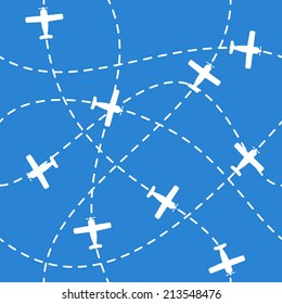 Seamless background with airplanes flying  with dashed lines as tracks or routes  on blue sky