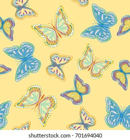 Seamless background from bright butterflies. Beautiful colorful butterflies chaotically fly. Seamless multicolored background with flying moths. Suitable for fabric, paper, packaging.