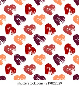 Seamless background with brush strokes hearts of different color