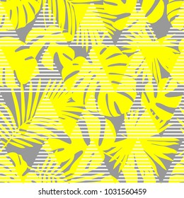 Seamless background with decorative yellow leaves. Pattern with Palm leaves. Textile rapport.