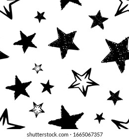 Seamless background of doodle stars. Black hand drawn stars on white background. Vector illustration