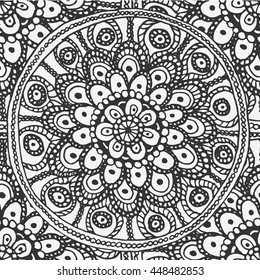 Seamless background from floral round black and white hand-painted mandala coloring, consisting of many parts.