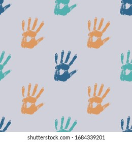 Seamless background made from colored handprints. Detail different colored hand-prints on white background. Multicolor backdrop for your design. Prints of hands - seamless pattern.