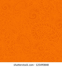 Seamless background made of paisley. Vivid orange.