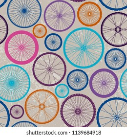 Seamless background pattern. Pattern with bycicles wheels. Vector image.