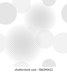 Seamless background pattern of circles including halftone effect in shades of light grey