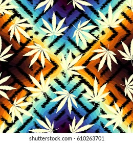Seamless background pattern. Grunge ethnic background and hemp leaves.
