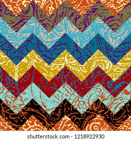 Seamless background pattern. Grunge paisley pattern in collage patchwork style. Ethnic indian style.