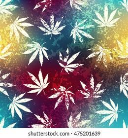 Seamless background pattern. Rastafarian blur background and grunge hemp leaves.