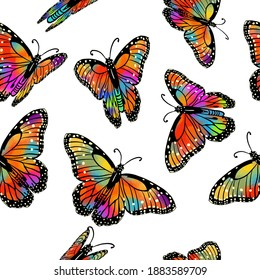 Seamless background with rainbow butterflies.