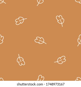 Seamless background single oak leaf gender neutral baby pattern. Simple whimsical minimal earthy 2 tone color. Kids nursery wallpaper or boho woodland nature fashion all over print.