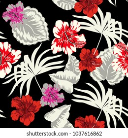 Seamless background with tropical flowers and leaves