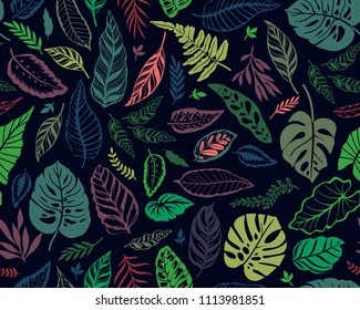 Seamless background with tropical leaves. Bright jungle pattern with leaves and exotic plant. The elegant template with Hawaiian motifs, on dark blue background.