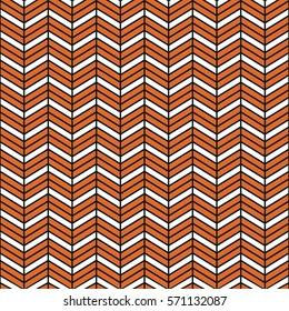 Seamless black and orange interchanging chevrons pattern vector