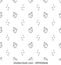Seamless black and white hand drawn pattern made with chickens in doodle style