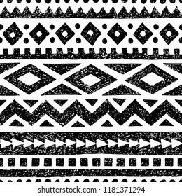Seamless black and white pattern. Ethnic and tribal motifs. Grunge texture painted in pencil. Vector illustration.