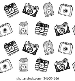 Seamless black and white pattern with hand drawn retro cameras