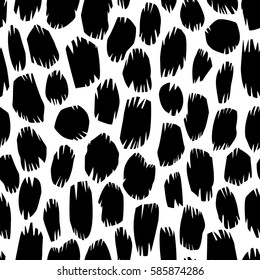 Seamless black and white vector background with animal print