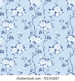 Seamless blue background with branches of roses. Floral pattern for wallpaper, fabric, digital paper, fills, etc. Shabby chic style.