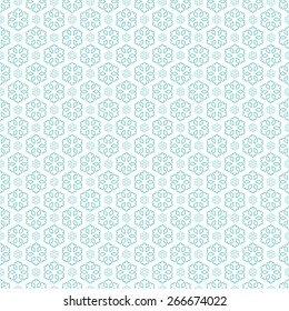 seamless blue and white colored snowflake background