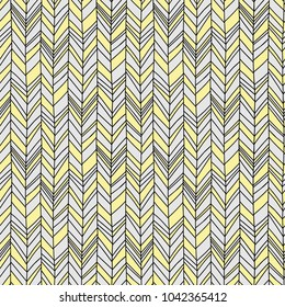 Seamless Boho Chevron. Hand drawn imperfect stripes in pale yellow and light to medium grey. Hot summer fashion trendy pattern.