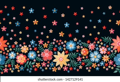 Seamless border with summer embroidered flowers. Colorful floral ornament. Print for fabric and textile.